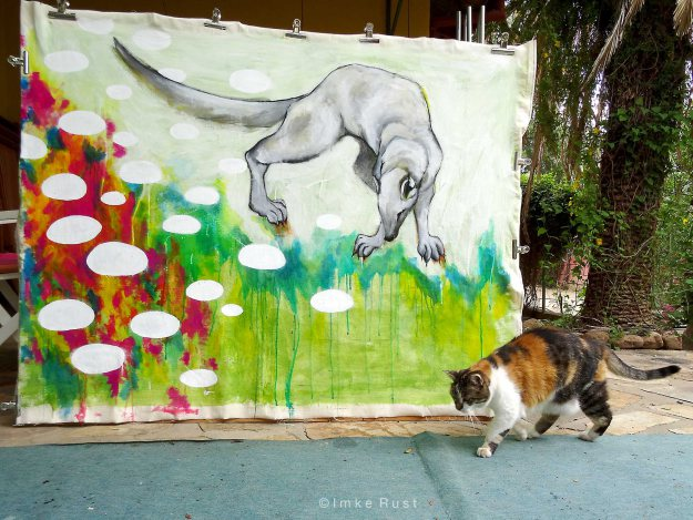 Clarissa, my cat, inspecting the last painting I have done in 2015 - an impression of a wild mongoose who visits us daily.